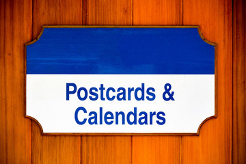 Postcards and calendars sign