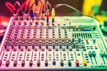 buttons on equipment in audio recording studio or nightclub