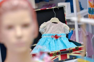 Baby blue dress hanging