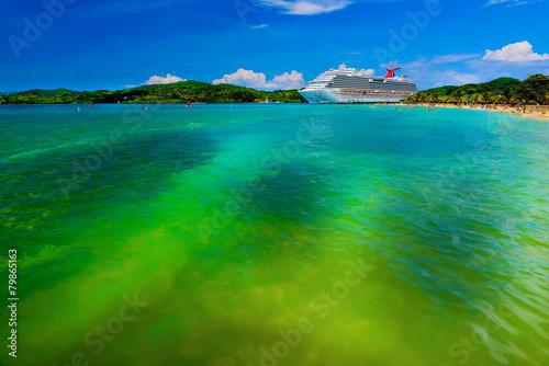 Leinwanddruck Bild Luxury cruise ship near the beach