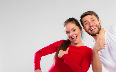Portrait of sporty young couple on blue