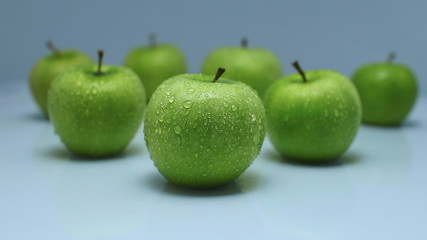 Juicy green apples with leaves, isolated on white