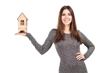 Woman with house in her hands isolated