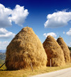 haystacks and blue sky