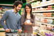 Couple choosing food in a supermarket - 79866578