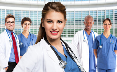 Doctor in front of a group of medical workers