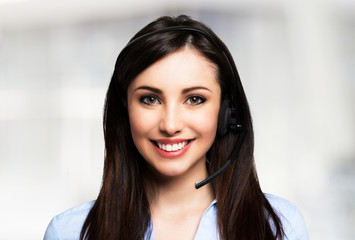 Smiling woman using an headset