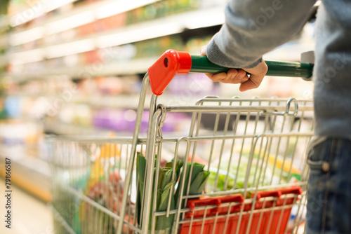 Leinwanddruck Bild Detail of a man shopping in a supermarket