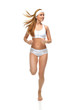 Happy young fitness beautiful slim sport woman jogging and runni