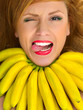 fashion woman with necklace of small yellow bananas smiling