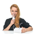 Young woman using nebulizer mask for respiratory inhaler Asthma