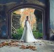 Beautiful bride posing in old ruined castle