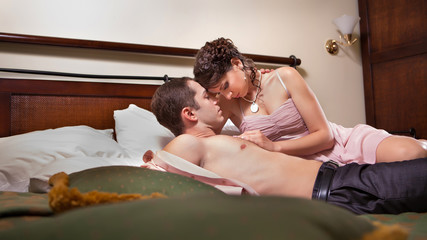 Beautiful couple in the bedroom