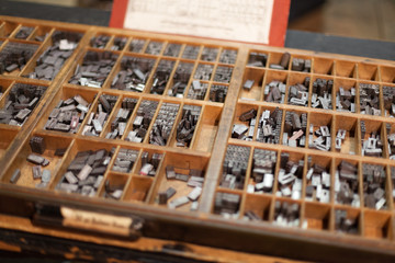 Metal letterpress letters in printing machine