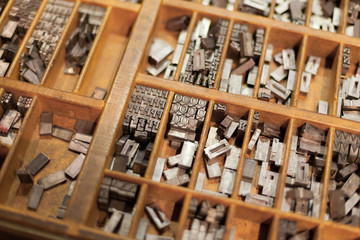 Close-up of metal letterpress letters in printing machine