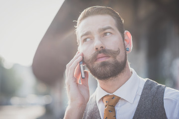 handsome big moustache hipster man calling with cellphone