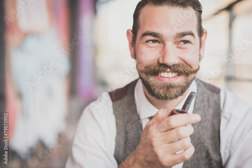 handsome big moustache hipster man smoking pipe - 79870903