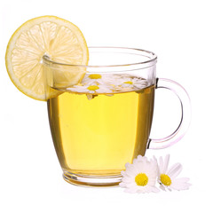 Cup of chamomile tea with chamomile flowers and lemon isolated