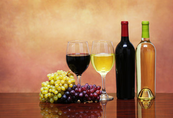 Bottles of Red and White Wine with Fresh Grapes. Glasses of Wine