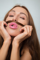 woman shows mustache