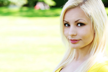 Portrait of beautiful blonde young woman. Outdoor