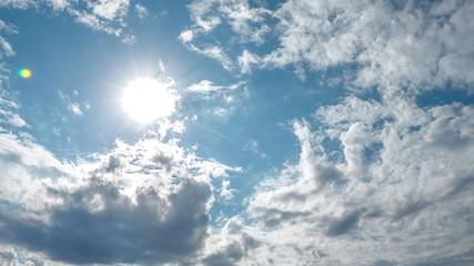 Spectacular sun bursting through clouds beautiful sky timelapse