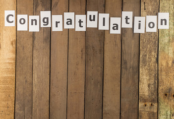 Word congratulation on wood