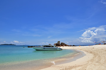 Beach with speedboat