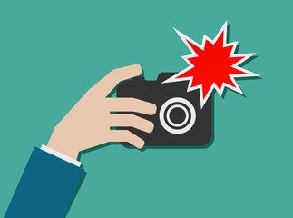 hand with photo camera and flash icon