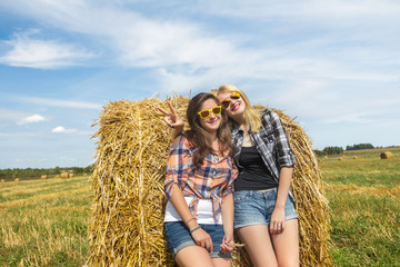 Girls enjoy sunny day together in countryside