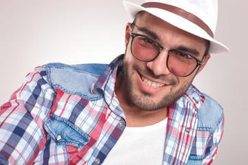 young fashion man smiling at the camera