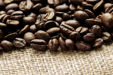 Arabica coffee beans on burlap background