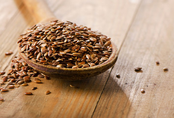 Flax seeds heap on  wooden spoon