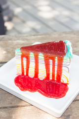 Strawberry rainbow cheese cake on wooden