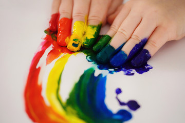 Children's fingers covered in paint