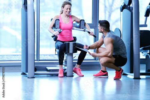 woman exercising with her personal trainer - 79879350