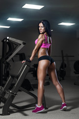 sexy young fitness girl resting after training