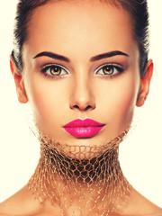 Fashion portrait of a beautiful  girl wears veil on neck. bright