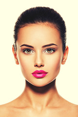 face of a beautiful young fashion woman with glamour makeup