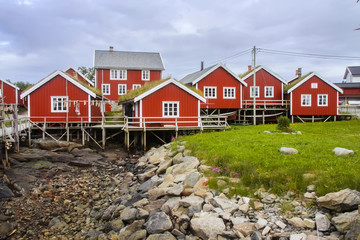 typical red wooden houses on the coast of Finland