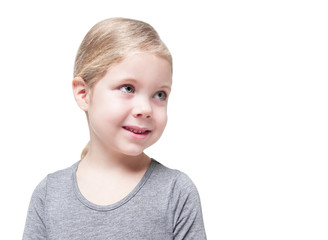 Beautiful little girl looking on something isolated