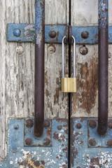 Old wooden door with locked padlock 2