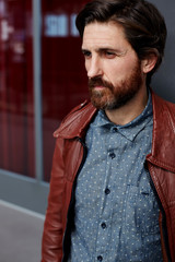Mature hipster man dressed leather jacket standing indoors