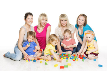 Children Group with Mothers Playing Toy Blocks. Little Kids