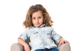 Blonde cute girl sitting on little armchair