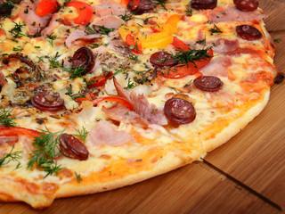 Tasty Italian pizza on wooden background