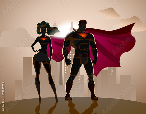 Superhero Couple: Male and female superheroes, posing in front o - 79885759