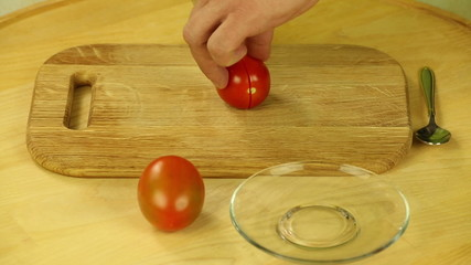 Cut tomatoes into the board