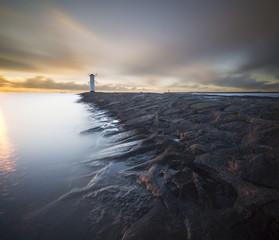 """Zachód słońca nad latarnią morską """"Stawa Młyny"""",Świnoujście"""