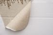 cardboard corrugated pattern with a torn corner, horizontal